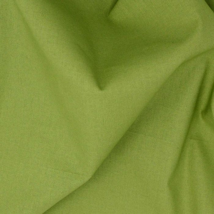 Plain solid fabric in apple green.