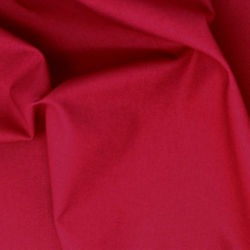 Wine red plain solid fabric.