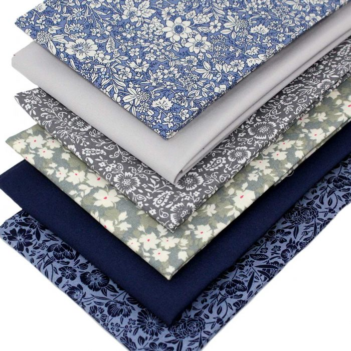 Set of floral fabrics in deep blue and grey.