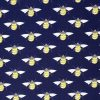 Bees on a navy blue fabric.