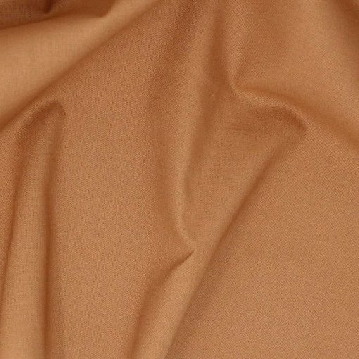 Brown tan plain solid fabric.