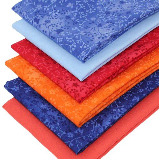 Blue and orange fat quarter fabrics.
