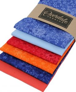 Fat quarter fabrics in orange and blue.