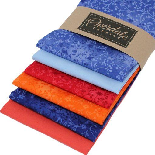 Fat quarter fabrics in orange and blue.