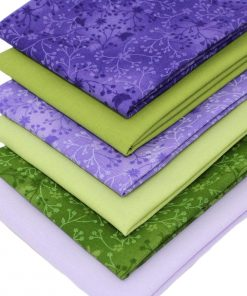 Quilting fabrics in lilac and green.