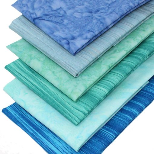 Blue and green batiks and linear fabrics.