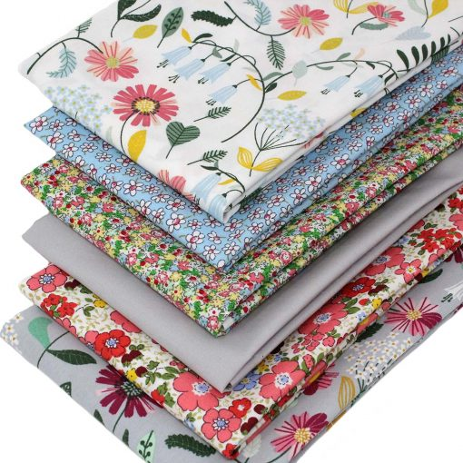 Floral fabric fat quarters in pink, grey and blue.