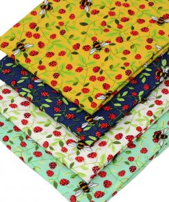 Bee fabrics in yellow, green and blue.