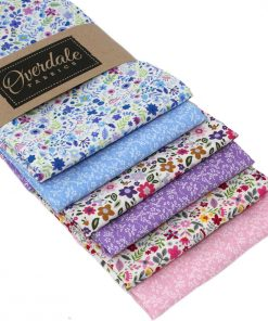 Miniature flower fat quarter fabrics in pinks, purples and blues.