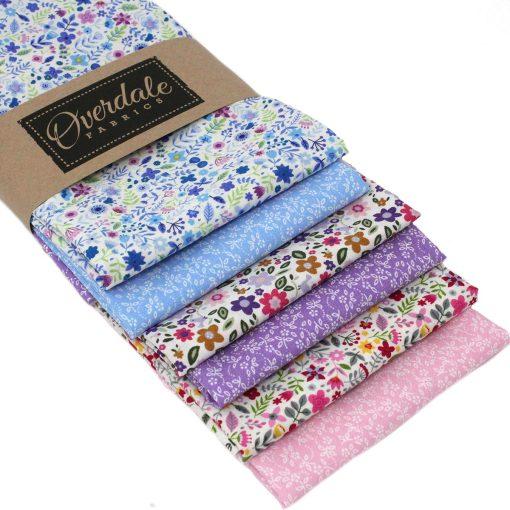 Miniature flower fat quarter fabrics in pinks, purples and blues.