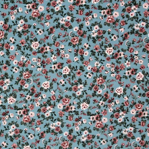 Blue floral fabric with a vintage look.