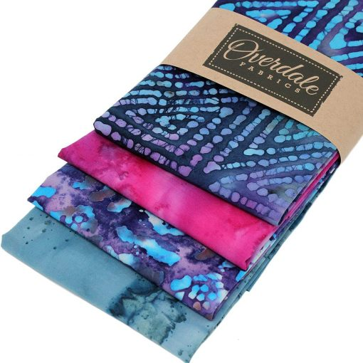 Batik fat quarters in blue, purple and pink.