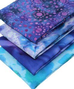 Fat quarters in blue and purple batiks.