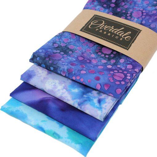 Batik fat quarter fabrics in blue and purple.