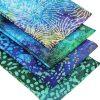 Vibrant batik fat quarters in blues, purples and greens.