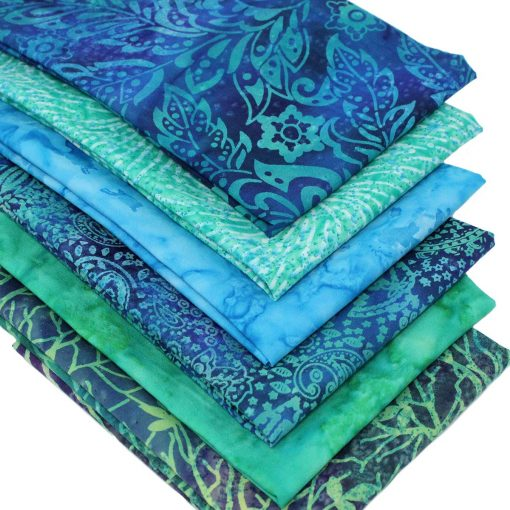 Batik fabrics in shades of blue and green.