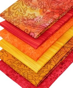 Rich orange and red cotton quilting fabrics.