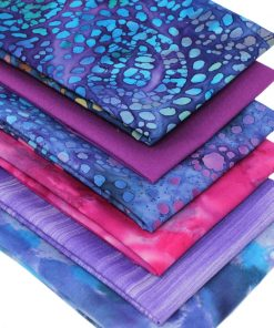 Batik fat quarter fabrics in shades of purple, pink, lilac and blue.