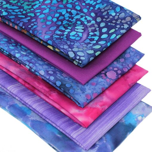 Batik fat quarter fabrics in shades of purple, pink, lilac and blue.