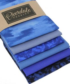 Rich blue fat quarter fabrics with dappled, mottled and plain designs.