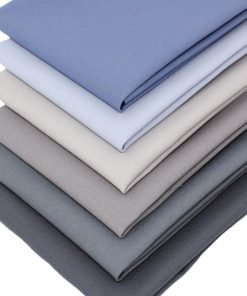 Plain solid fabrics in shades of blue and grey.