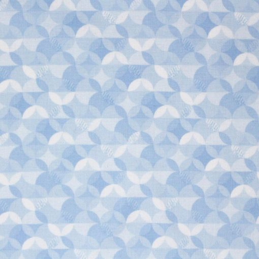 Pale blue fabric with a circular pattern by Riley Blake.