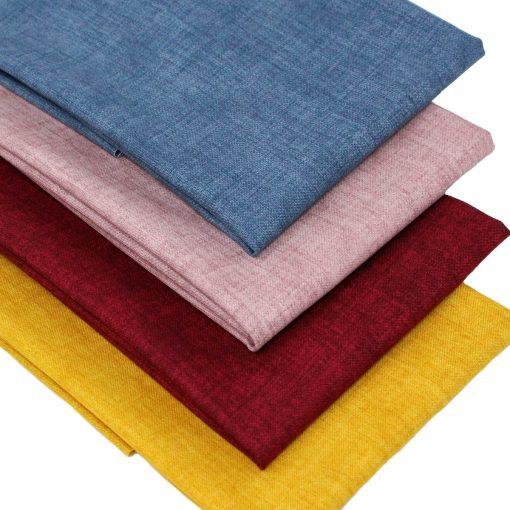 Fat quarter fabrics in deep rich colours with a linen texture.