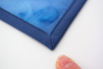 tutorial how to bind a quilt with mitred coreners