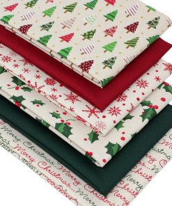 Christmas fat quarter bundle featuring festive designs in red and green.