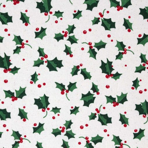 Christmas fabric featuring green holly leaves with red berries.