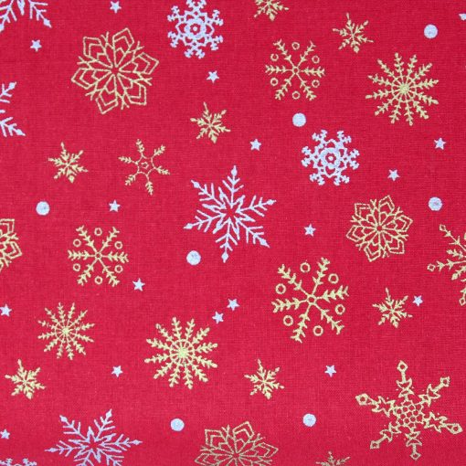 Christmas fabric in red with gold and silver snowflakes.