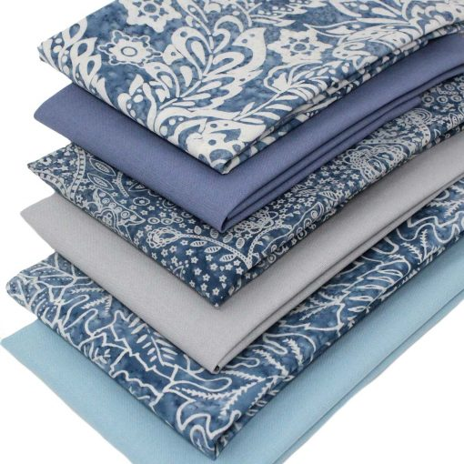 Batik and plain solid fabrics in shades of blue and grey.