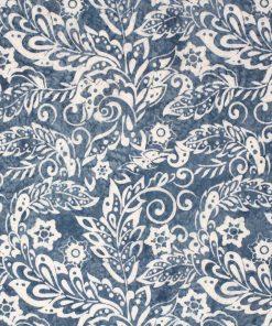 Pale blue batik with a decorative leaf design in white.