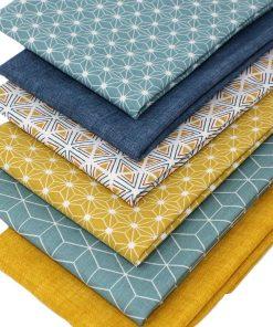 Geometric fat quarter fabrics in mustard and blue.