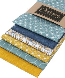 Fat quarter fabrics in ochre and blue featuring geometric designs.