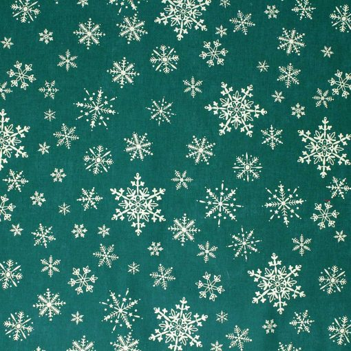 Dark green fabric featuring gold snowflakes.