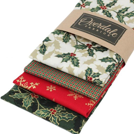 Christmas fat quarter fabrics featuring holly leaves.