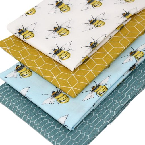 Fabrics featuring bees and honey comb.