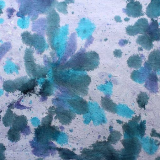 Purple and lilac batik fabric with a water splash design.
