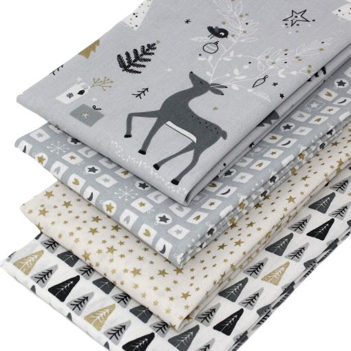 Christmas reindeer and forest fabrics in grey, white and gold.