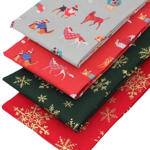 Christmas fabrics featuring dogs and snowflakes.