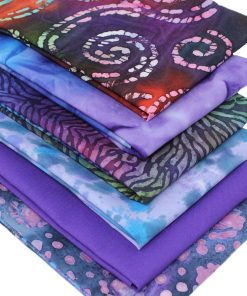Fat quarter batik bundle in purple and blue.