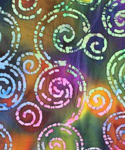 Handdrawn swirls on a deep rich batik fabric.