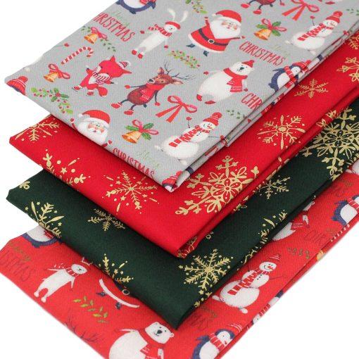Fun Christmas fat quarter fabrics featuring festive characters.