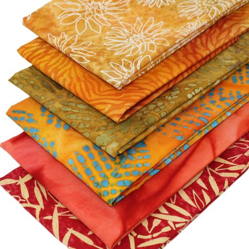 Orange batiks in a fat quarter bundle.