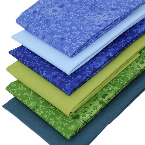 Fat quarter fabrics in shades of blue and green.