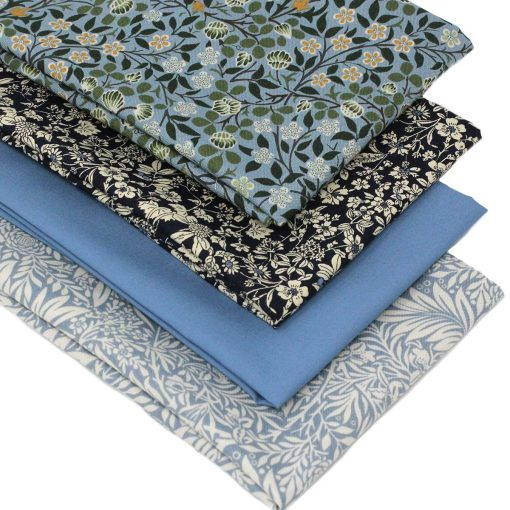 Blue arts and crafts designs on fat quarter fabrics in shades of blue.