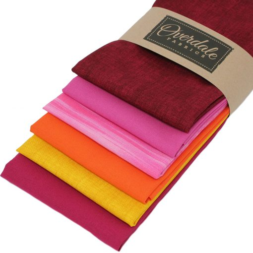 Textured and plain solid fabrics in rich warm colours.