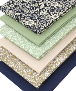 Floral and plain solid fabrics in shades of green, beige and navy blue.