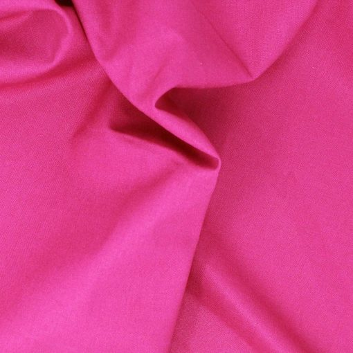 Bright rich pink plain solid fabric.